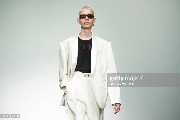 Model presents a creation by British fashion house John Lawrence Sullivan during a catwalk show at London Fashion Week Men's June 2017 in London on...