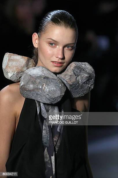 Model presents a creation by British-based Turkish Cypriot designer Hussein Chalayan during the autumn/winter 2008-2009 ready-to-wear collection show...