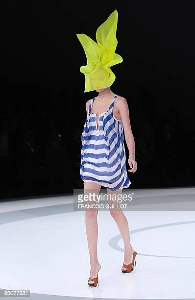 A model presents a creation by Britishbased Turkish Cypriot designer Hussein Chalayan during the spring/summer 2009 readytowear collection show in...