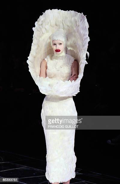 A model presents a creation by Britishn designer Alexander McQueen during the autumn/winter 2009 readytowear collection show in Paris on March 10...