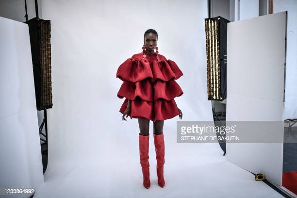 Model presents a creation by Cameroonian fashion designer Imane Ayissi during the shooting of the video presentation of his Haute Couture Fall Winter...