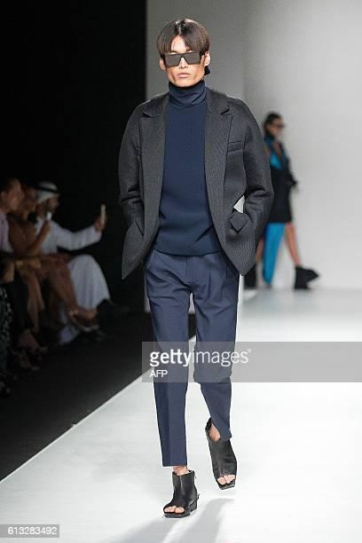 A model presents a creation by CanadianJordanian designer Rad Hourani at the Arab Fashion Week in Dubai on October 7 2016 Hourani creates avantgarde...