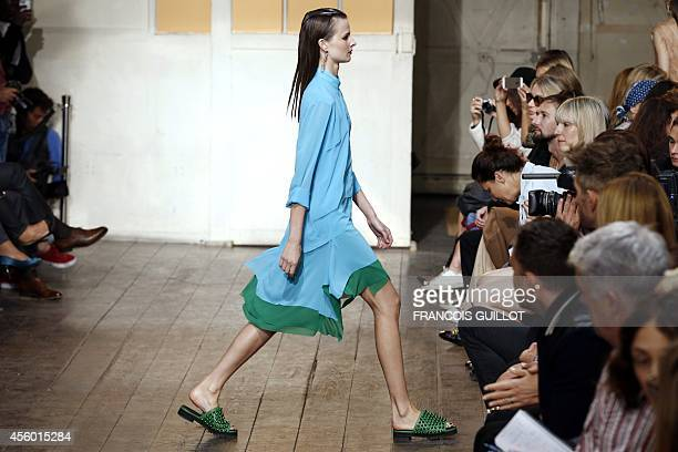 A model presents a creation by Cedric Charlier during the 2015 Spring/Summer readytowear collection fashion show on September 24 2014 in Paris AFP...