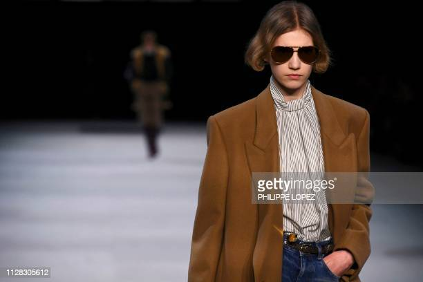 Model presents a creation by Celine during the Women's Fall-Winter 2019/2020 Ready-to-Wear collection fashion show in Paris, on March 1, 2019.