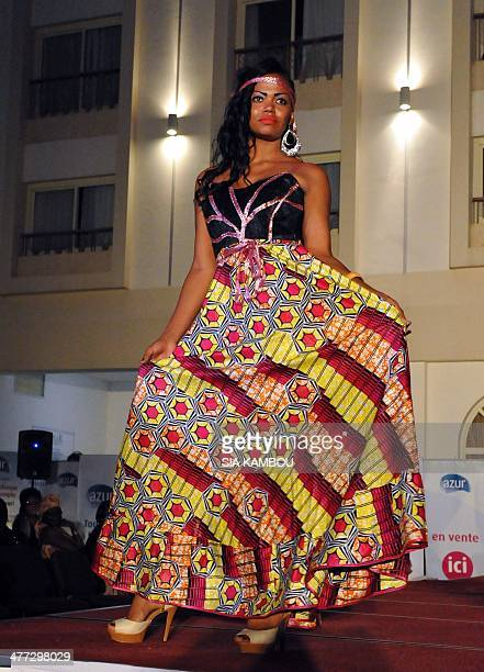 A model presents a creation by Central African fashion designer Sonia Bafounga during a fashion show on the theme 'women fashion and peace' to mark...