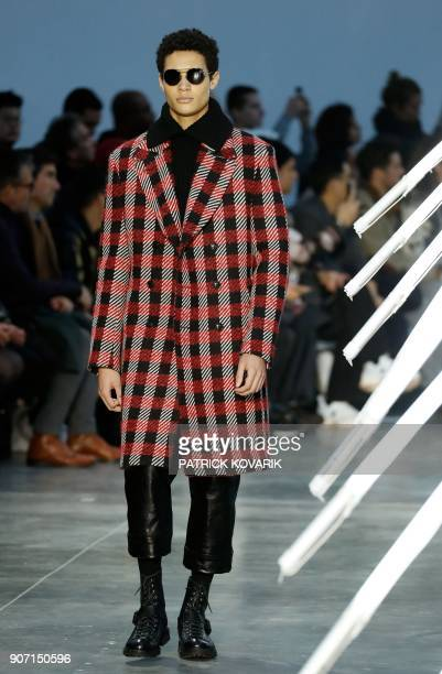 Model presents a creation by Cerrutti during the men's Fashion Week for the Fall/Winter 2018/2019 collection in Paris on January 19, 2018. / AFP...