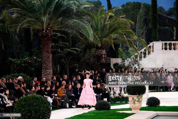 A model presents a creation by Chanel during the 2019 SpringSummer Haute Couture collection fashion show at the Grand Palais in Paris on January 22...