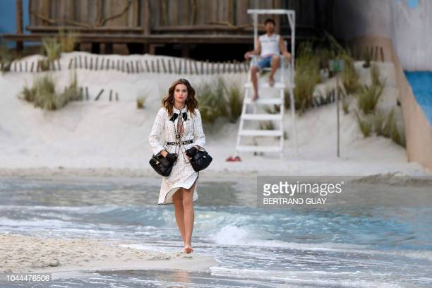 TOPSHOT A model presents a creation by Chanel during the SpringSummer 2019 ReadytoWear collection fashion show at the Grand Palais in Paris on...