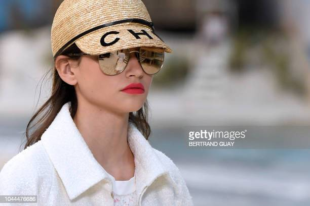 A model presents a creation by Chanel during the SpringSummer 2019 ReadytoWear collection fashion show at the Grand Palais in Paris on October 2 2018
