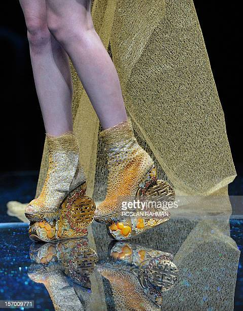 Model presents a creation by Chinese designer Guo Pei during the Asian Couture 2012 Women Fashion Week in Singapore on November 27, 2012. AFP...