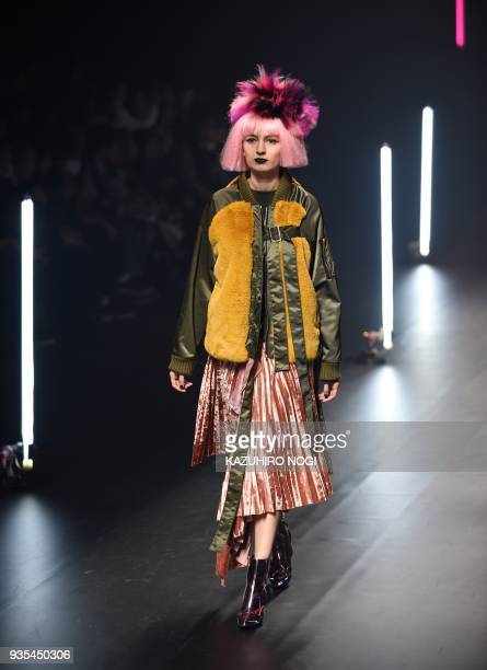 A model presents a creation by Chineseborn designer Viviano Sue for his 2018 autumn/winter collection at Tokyo Fashion Week in Tokyo on March 21 2018...