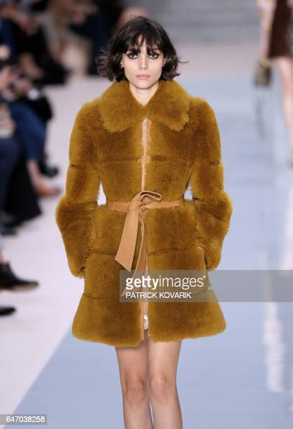 A model presents a creation by Chloe during the women's FallWinter 20172018 readytowear collection fashion show in Paris on March 2 2017 / AFP PHOTO...