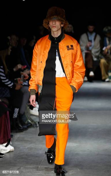 A model presents a creation by Christian Dada during men's Fashion Week for the Fall/Winter 2017/2018 collection in Paris on January 20 2017 / AFP...