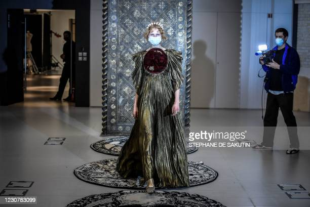 Model presents a creation by Christian Dior during a fitting session at Christian Dior's Haute Couture fashion house in Paris on January 20, 2021. -...