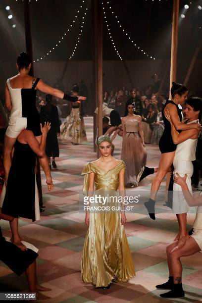 Model presents a creation by Christian Dior during the 2019 Spring-Summer Haute Couture collection fashion show in Paris, on January 21, 2019.