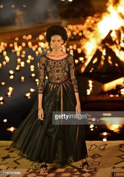 A model presents a creation by Christian Dior during the Croisiere 2020 collection fashion show at Badi palace in the Moroccan city of Marrakesh on...