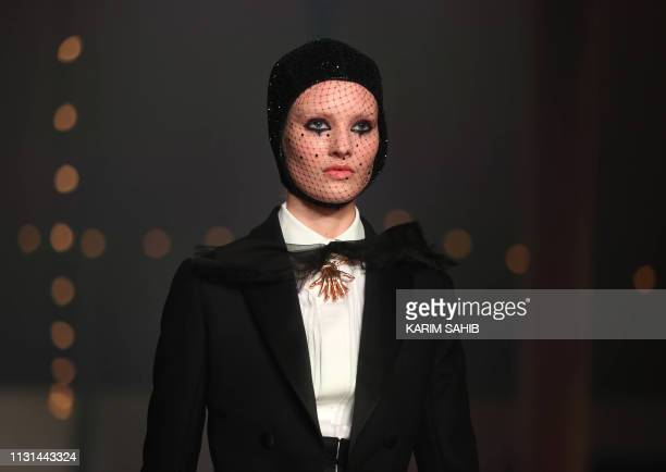 Model presents a creation by Christian Dior during the Haute Couture Spring-Summer 2019 collection fashion show in the emirate of Dubai on March 18,...