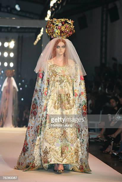 A model presents a creation by Christian Lacroix during Paris Haute Couture Fashion Week for Fall/Winter 2007 2008 in Paris France on July3 2007 at...