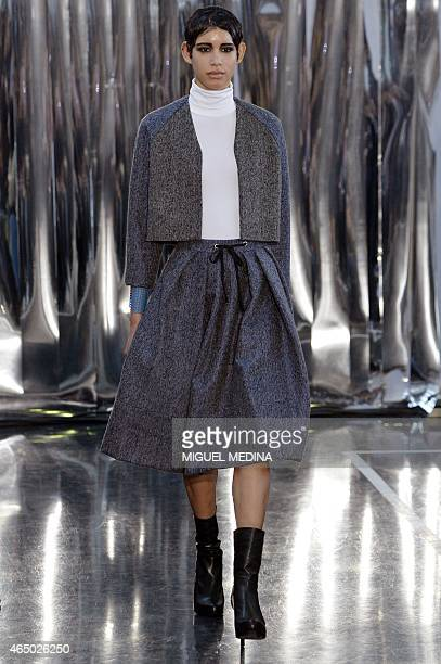 A model presents a creation by Christine Phung during the 20152016 fall/winter readytowear collection fashion show on March 3 2015 in Paris AFP PHOTO...