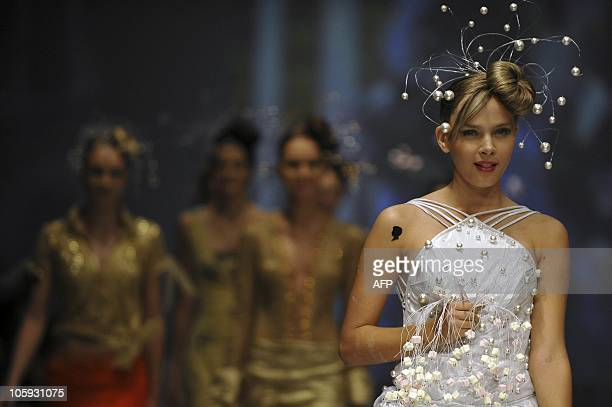 A model presents a creation by Colombian designer Diego Morales during the third day of the Cali Exposhow on October 21 in Cali Valle del Cauca...