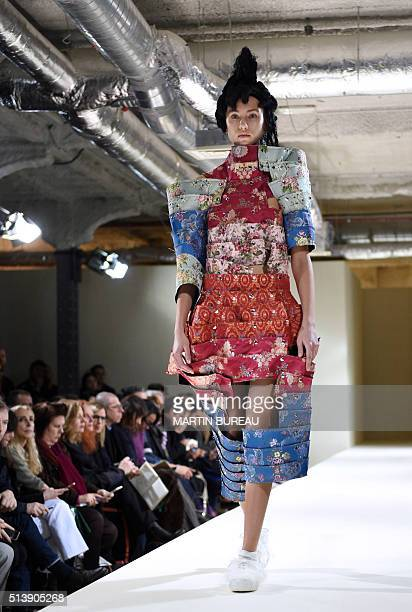 9a7424cb7b86 A model presents a creation by Comme Des Garcons during the 20162017  fall winter readytowear