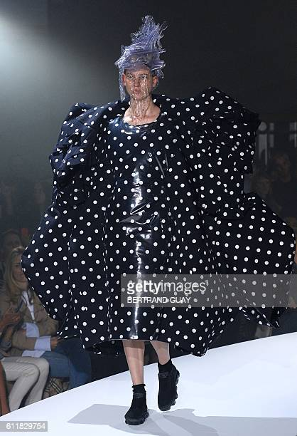 A model presents a creation by 'Comme des garcons' during the 2017 Spring/Summer readytowear collection fashion show on October 1 2016 in Paris / AFP...