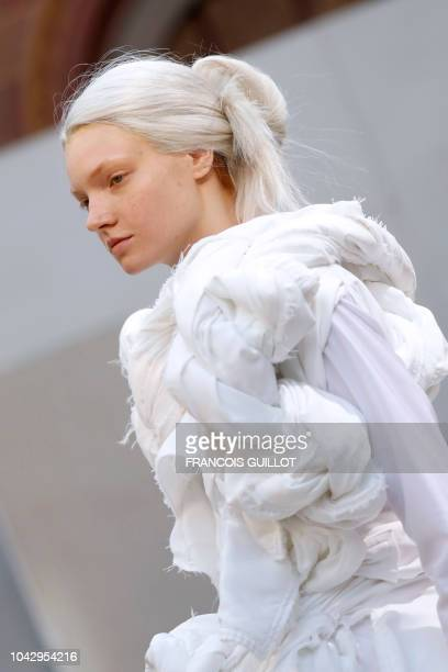Model presents a creation by Comme des Garcons during the Spring-Summer 2019 Ready-to-Wear collection fashion show in Paris, on September 29, 2018.