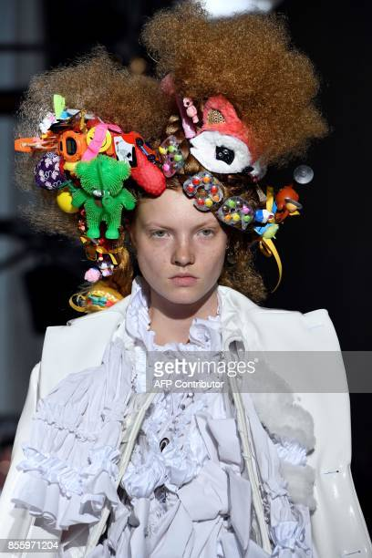 Model presents a creation by Comme des garcons, during the women's 2018 Spring/Summer ready-to-wear collection fashion show in Paris, on September...