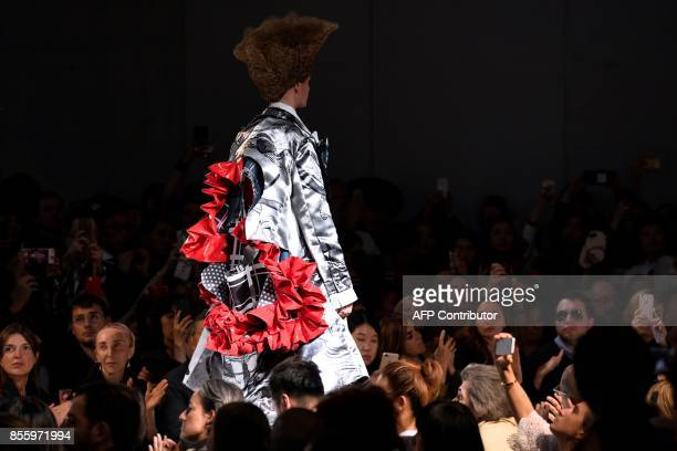 A model presents a creation by Comme des garcons during the women's 2018 Spring/Summer readytowear collection fashion show in Paris on September 30...