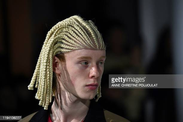 Model presents a creation by Comme Des Garçons, during the men's Fall/Winter 2020/2021 collection fashion show in Paris on January 17, 2020.
