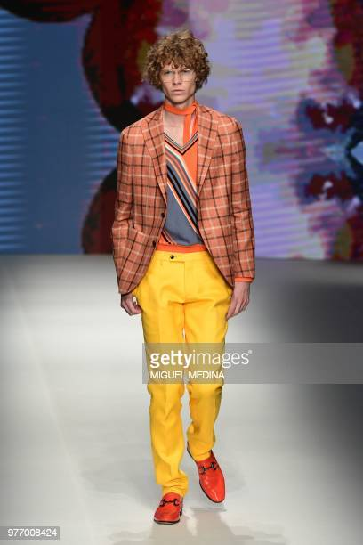 Model presents a creation by DAKS during the men & women's spring/summer 2019 collection fashion show in Milan, on June 17, 2018.