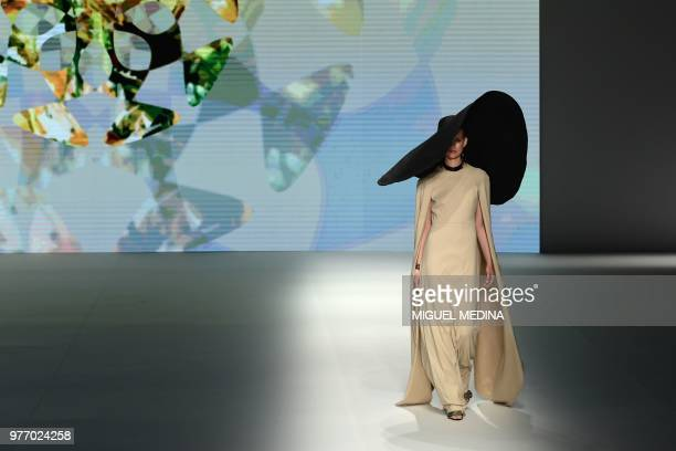 A model presents a creation by DAKS during the men women's spring/summer 2019 collection fashion show in Milan on June 17 2018