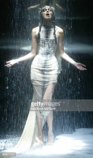 A model presents a creation by designer Alexander McQueen during the 'Black' fashion show in London 03 June 2004 The show sponsored by British...