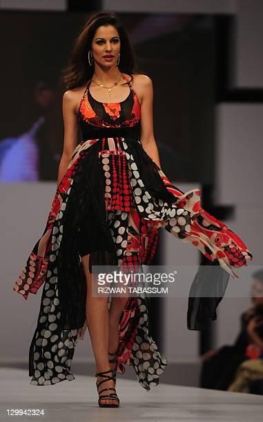 A model presents a creation by designer Ammar Belal during PFDC Sunsilk Fashion Week in Karachi on October 22 2011 AFP PHOTO/ Rizwan TABASSUM