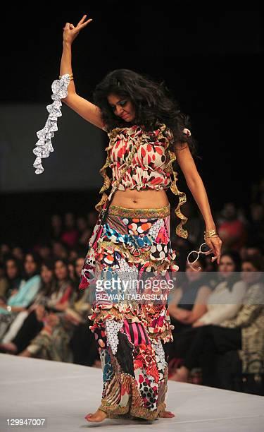 A model presents a creation by designer Ammar Belal during the PFDC Sunsilk Fashion Week in Karachi on October 22 2011 AFP PHOTO / RIZWAN TABASSUM