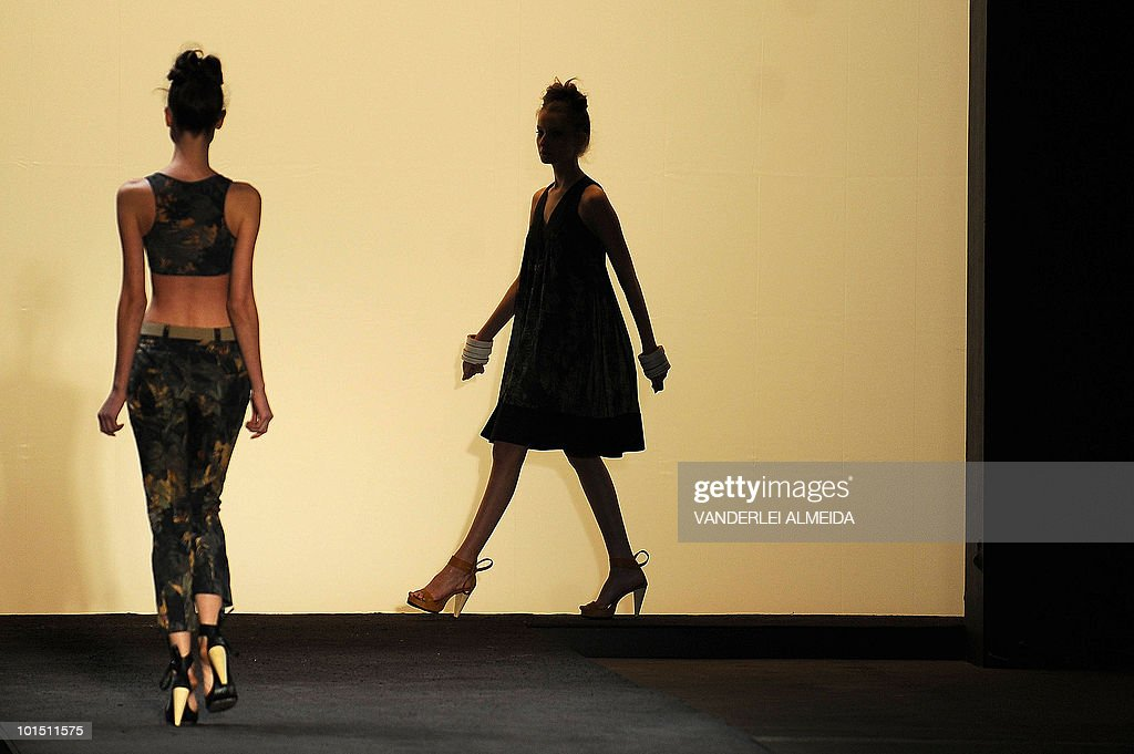 A model presents a creation by designer Andrea Nascimento during the Rio Fashion Week Summer 2010/2011 collection, at the Pier Maua in Rio de Janeiro, Brazil on June 1, 2010.