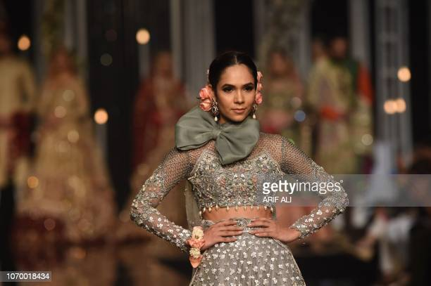 A model presents a creation by designer Aosadya during the Pantene Hum Bridal Couture Week in Lahore on December 8 2018