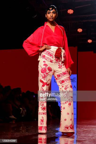Model presents a creation by designer Ashdeen during the Lakmé Fashion Week 2020 Summer/Resort fashion show in Mumbai on February 13, 2020. / --...
