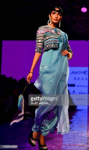 A model presents a creation by designer Ashdeen during the Lakmé Fashion Week 2020 Summer/Resort fashion show in Mumbai on February 13 2020 / IMAGE...