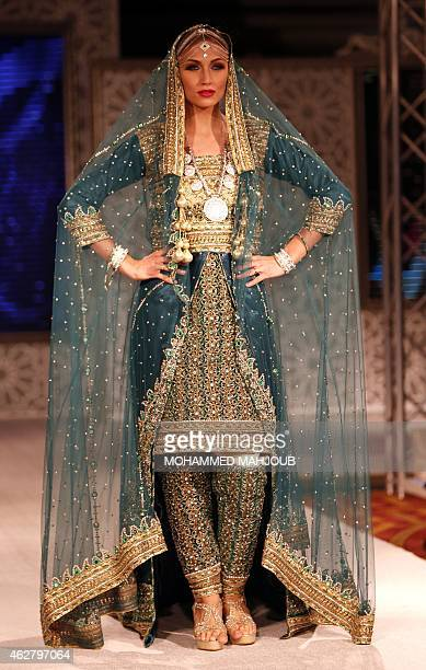 A model presents a creation by designer Faiza alBalushi during a fashion show organised as part ot the Muscat Festival on February 5 2015 in the...