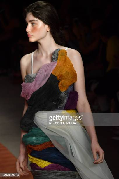 A model presents a creation by designer Fernanda Yamamoto during the Sao Paulo Fashion Week in Sao Paulo Brazil on April 24 2018