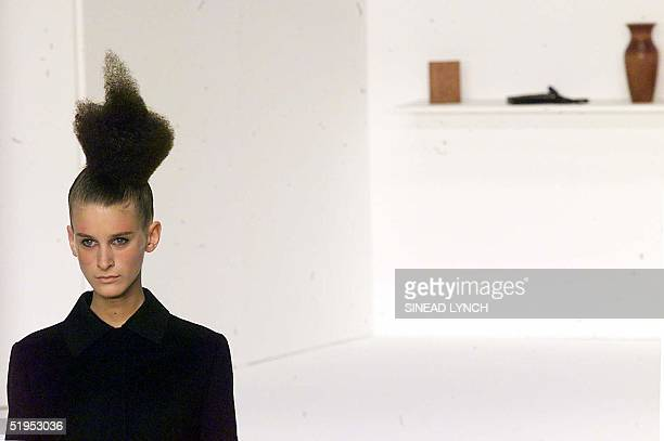 A model presents a creation by designer Hussein Chalayan during London Fashion week 16 February 2000