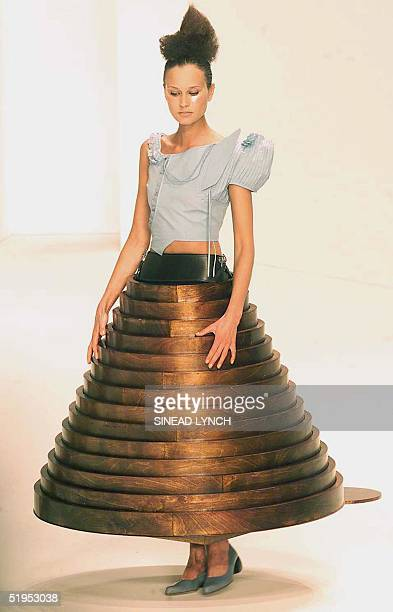 A model presents a creation by designer Hussein Chalayan during London Fashion week 16 Febuary 2000