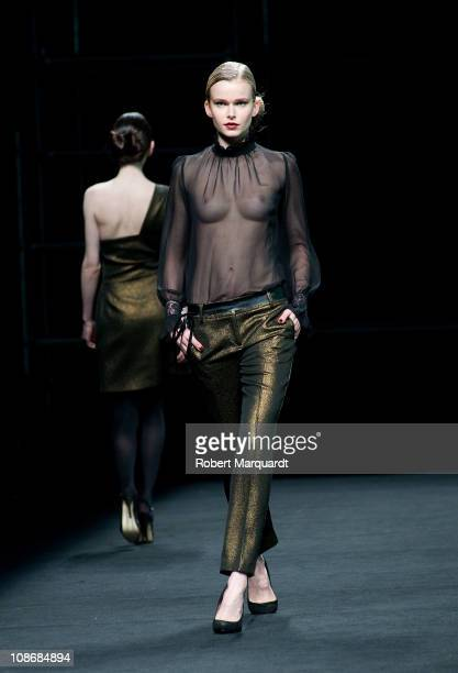 A model presents a creation by designer Justicia Ruano on February 1 2011 in Barcelona Spain