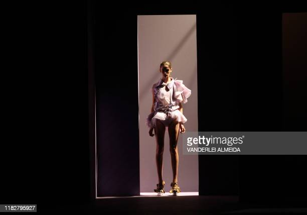 Model presents a creation by designer Luiza Bonadimam during the Rio Fashion Week Spring-Summer 2008-09 collection, at the Marina da Gloria on June...