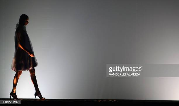 A model presents a creation by designer MaraMac during the Rio Fashion Week SpringSummer 200809 collection at the Marina da Gloria on June 9 2008 in...