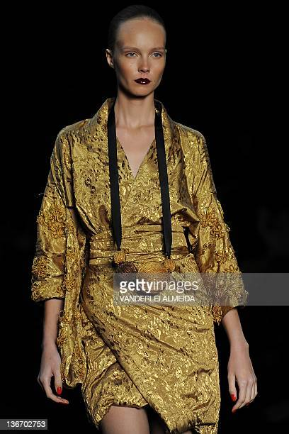A model presents a creation by designer Patachou during first day of the Rio Fashion Week Winter 2012 collection at the Pier Maua in Rio de Janeiro...