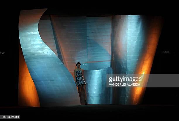 A model presents a creation by designer Patachou during the Rio Fashion Week Summer 2010/2011 collection at the Pier Maua in Rio de Janeiro Brazi lon...