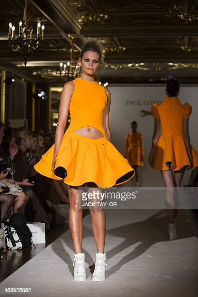 A model presents a creation by designer Paul Costelloe during their 2016 spring / summer catwalk show at London Fashion Week in London on September...