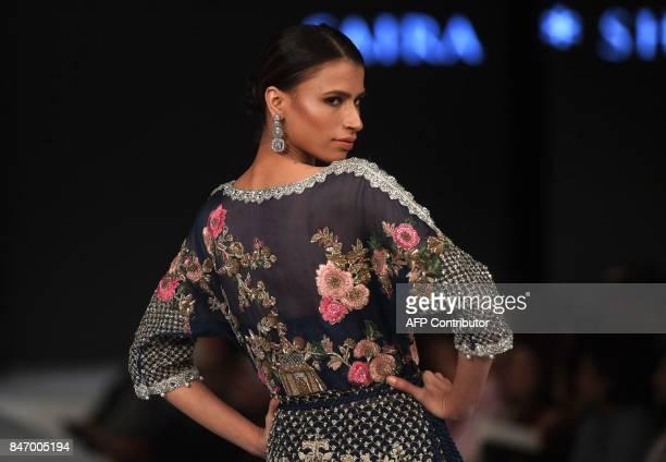 Model presents a creation by designer Saira Shakira on the last day of the Fashion Pakistan Week Winter Festive 17, in Karachi on September 14, 2017....